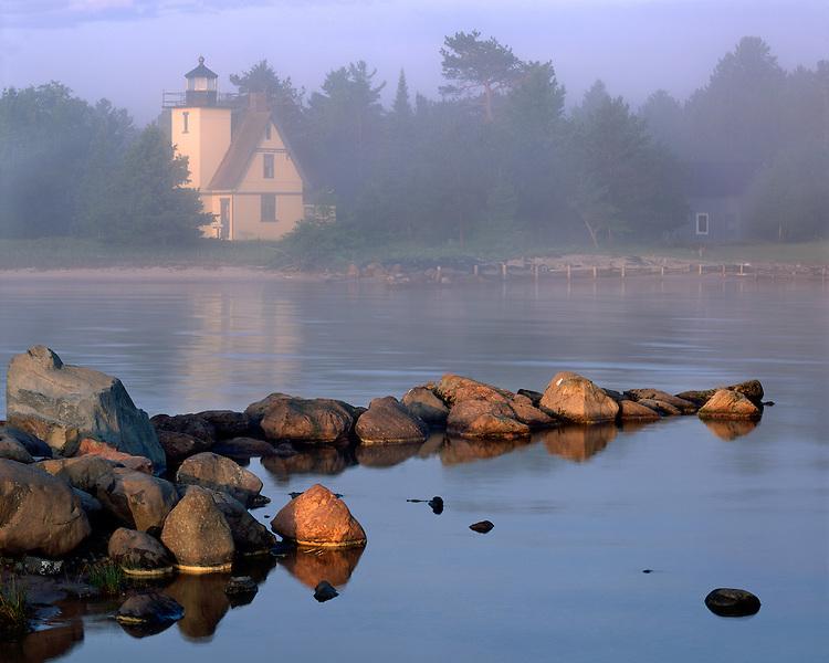 Foggy sunrise light on the Bete Grise Lighthouse on Lake Superior; Upper Peninsula, MI