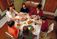 CAJUN FAMILY EATING DINNER AT HOME IN THE DINING ROOM. CAJUN FAMILY. EUNICE LOUISIANA.