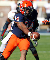 Virginia Cavaliers quarterback Phillip Sims (14) hands off the ball during the game against Maryland in Charlottesville, Va. Maryland defeated Virginia 27-20.