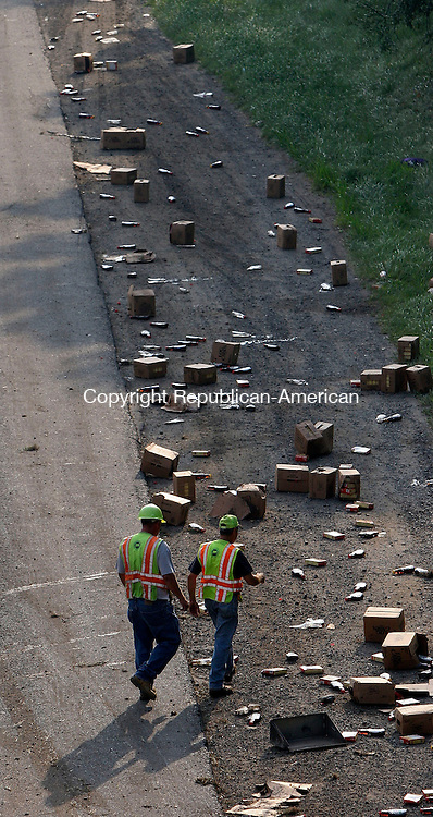 MIDDLEBURY, CT-28July 2006-072806TK03-  Connecticut DOT workers inspect the scattered bottled maple syrup cargo carried the tractor trailer. Tom Kabelka Republican-American (Tractor accident, South Street bridge)