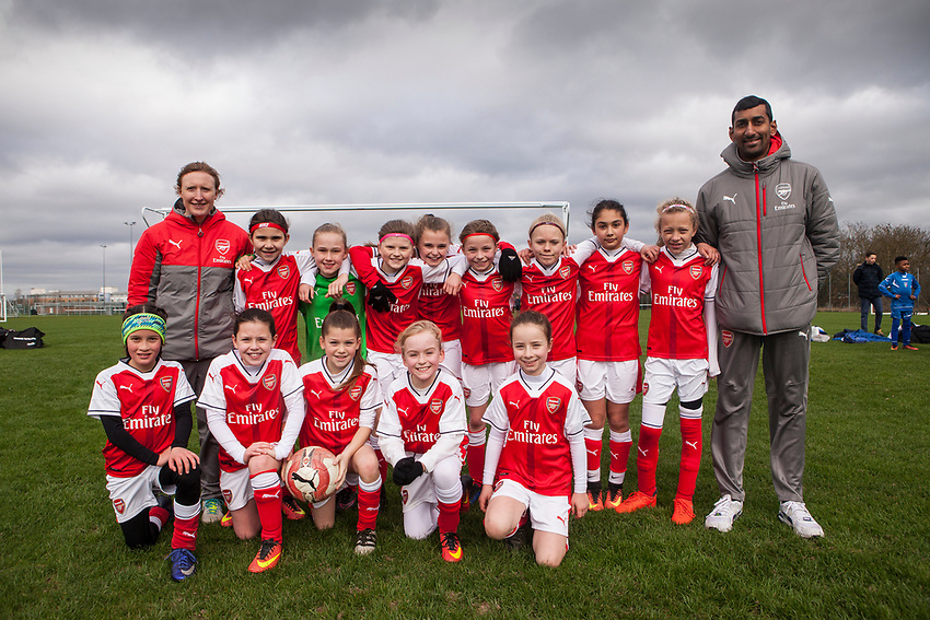 Arsenal Ladies Under 10 Football Team with Coach Rupen Shah. Arsenal Ladies Under 10 and AC Finchley boys team play a football game at Univeristy of Hertfordshire's campus sports village  football pitch in Hatfield.