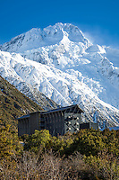 Mt Sefton towers above the Hermitage Hotel, Aoraki Mt Cook Village NZ.  Portrait / Vertical