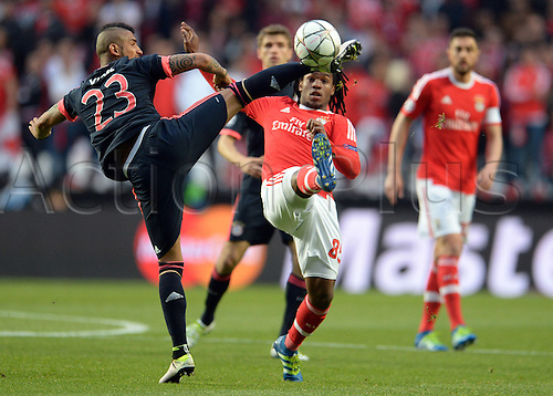 13.04.2016. Lisbon, Portugal.  Munich's Arturo Vidal (L) in action against Benifica's Renato Sanches (R) during the UEFA Champions League quarterfinal second leg soccer match between SL Benfica and FC Bayern Munich at Luz Stadium in Lisbon, Portugal, 13 April 2016.