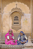 Indian women in traditional sari at a haveli, a mansion in Jaisalmer, India
