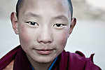 Young curious monk boy at Drakar Tredzong.  He was sad to see us guy -  He was a little joker too....Brian Hirschy Photograph :  Lights//Camera//Joy.www.brianhirschy.com ( http://www.brianhirschy.com )