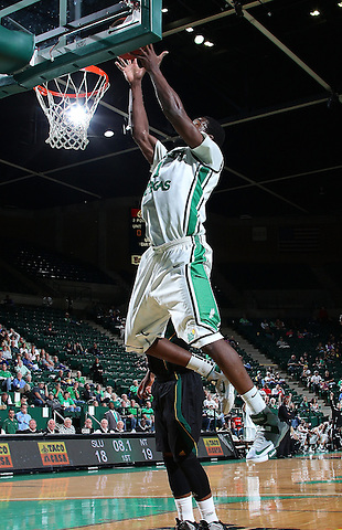 DENTON, TX - DECEMBER 16: Jacob Holmen #1 of the North Texas Mean Green rebounds and makes two against the Southeastern Louisiana Lions at the UNT Coliseum on December 16, 2012 in Denton, Texas. (Photo by Rick Yeatts/Getty Images)