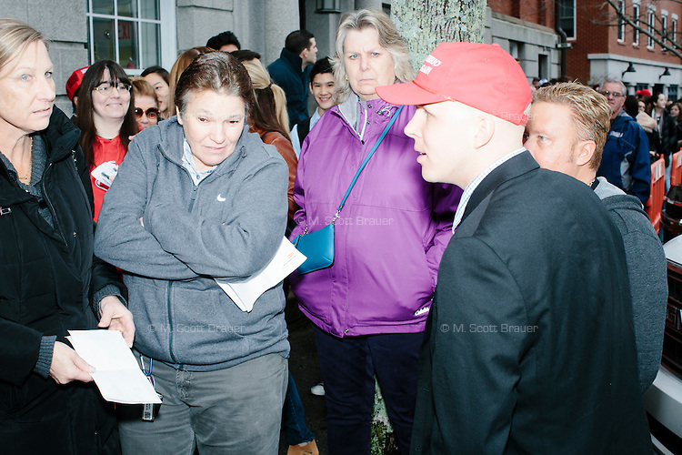 People line up to get in before real estate mogul and Republican presidential candidate Donald Trump speaks at a rally at Exeter Town Hall in Exeter, New Hampshire, on Thurs., Feb. 4, 2016.