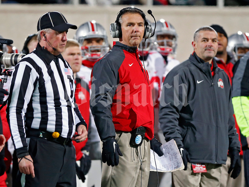 Ohio State Buckeyes head coach Urban Meyer watches as Michigan State Spartans misses a field goal during the 2nd quarter at Spartan Stadium in East Lansing, Michigan on November 8, 2014.  (Dispatch photo by Kyle Robertson)