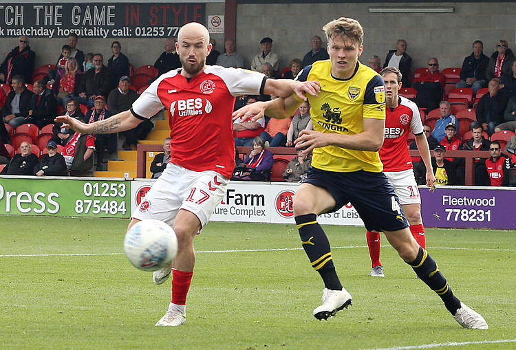 Fleetwood Town's Paddy Madden vies for possession with Oxford United's Rob Dickie<br /> <br /> Photographer Rich Linley/CameraSport<br /> <br /> The EFL Sky Bet League One - Fleetwood Town v Oxford United - Saturday 7th September 2019 - Highbury Stadium - Fleetwood<br /> <br /> World Copyright © 2019 CameraSport. All rights reserved. 43 Linden Ave. Countesthorpe. Leicester. England. LE8 5PG - Tel: +44 (0) 116 277 4147 - admin@camerasport.com - www.camerasport.com