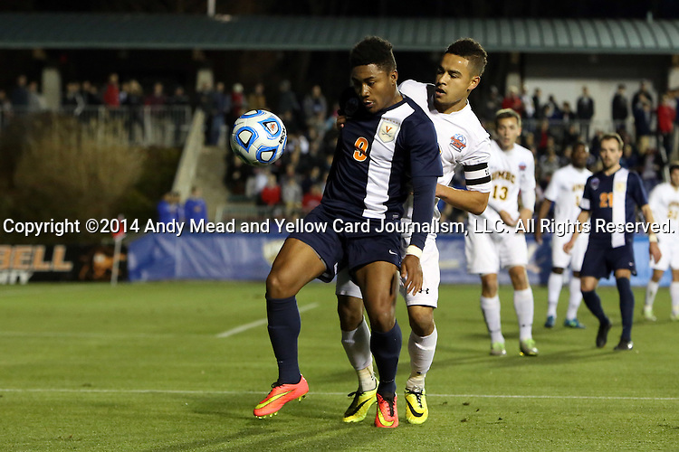 12 December 2014: Virginia's Darius Madison (9) is defended by UMBC's Marquez Fernandez (behind). The University of Virginia Cavaliers played the University of Maryland Baltimore County Retrievers at WakeMed Stadium in Cary, North Carolina in a 2014 NCAA Division I Men's College Cup semifinal match.