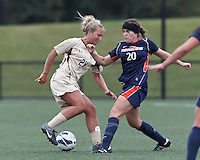 Boston College forward Rachel Davitt (24) dribbles as Pepperdine University forward/midfielder Amanda LeCave (20) challenges. Pepperdine University defeated Boston College,1-0, at Soldiers Field Soccer Stadium, on September 29, 2012.