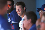 Los Angeles Dodgers' Clayton Kershaw talks with teammates in the dugout of a spring training game in Glendale, Ariz., on Saturday, March 19, 2016. <br />
