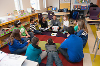 Salve Regina volunteers work with children from the Pell School in Newport as they learn language skills as part of a Modern Languages Program.