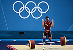 LONDON, ENGLAND - AUGUST 3:  Apti Aukhadov of Russia celebrates a successful silver medal lift lift during the Men's 85Kg Weightlifting Final Day 7 of the London 2012 Olympic Games on August 3, 2012 at the Excell Center in London, England. (Photo by Donald Miralle)