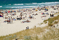 Crowds sunbathing on the Biscarrosse beach in Aquitaine, France.