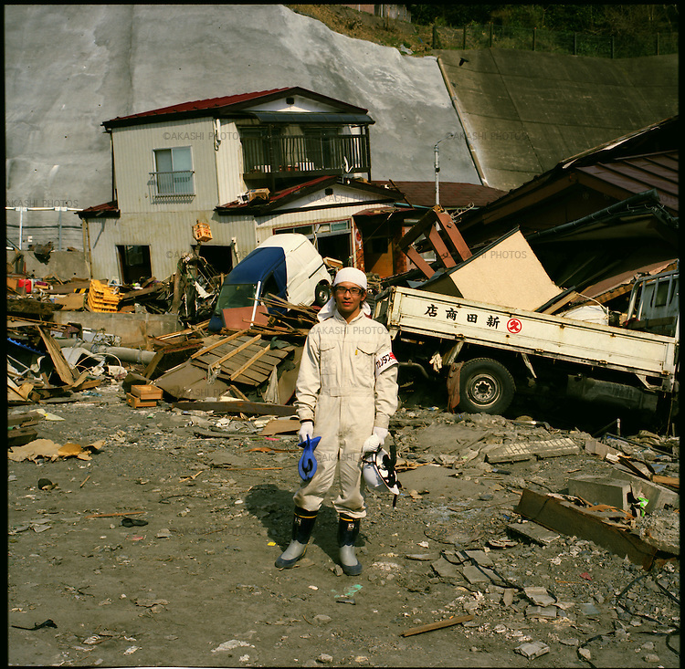 "Yuki Hashimoto, 22, a volunteer worker from Tokyo, helping to remove debris in the tsunami-affected area in Kamaishi, Iwate, in one month after the earthquake and tsunami. ""I wanted to do something for the victims, but I did not know what I can do,"" Hashimoto said. When he was feeling almost guilty that he could not do anything for them, he received an email that is looking for a volunteer worker to clean up the debris. He applied right away. ""I came here to help people because I felt sorry,"" he said. After working for them, he noticed that it was a kind of self-satisfaction and arrogant of him. ""Now, I feel more humble and grateful that they let me help them,"" he said.<br />