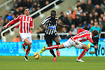 Moussa Sissoko of Newcastle United runs past an outstretched leg from Stoke's Marc Muniesa - Newcastle United vs. Stoke City - Barclay's Premier League - St James' Park - Newcastle - 08/02/2015 Pic Philip Oldham/Sportimage