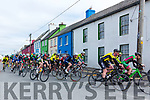 The main field of cyclists going through Portmagee on Easter Sunday on Stage 3 of the Rás Mumhan about 2 minutes behind the two leaders and facing into the Cat 1 climb of Coomanaspic.