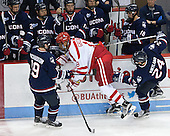 Evan Richardson (UConn - 19), Jordan Greenway (BU - 18), Patrick Kirtland (UConn - 24) - The Boston University Terriers defeated the visiting University of Connecticut Huskies 4-2 (EN) on Saturday, October 24, 2015, at Agganis Arena in Boston, Massachusetts.
