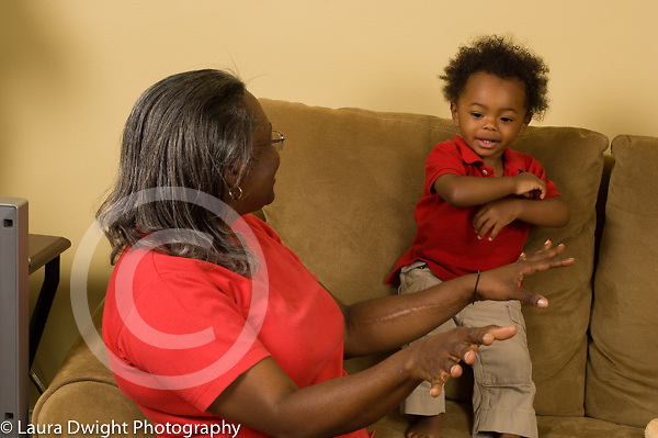 16 month old toddler baby boy with grandmother singing doing song with hand motions language development horizontal