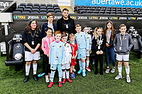 Former Swansea player Michu with children mascots during the Premier League game between Swansea City v Chelsea at the Liberty Stadium, Swansea, Wales, UK. Saturday 28 April 2018