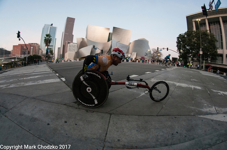 Handicapped racer at the L.A. Marathon passes the Disney Concert Hall.