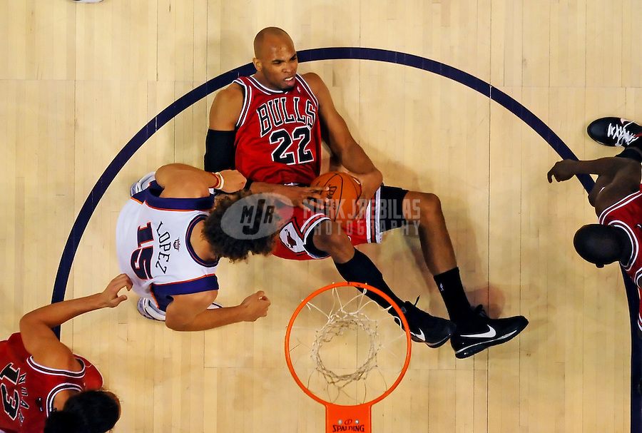 Jan. 22, 2010; Phoenix, AZ, USA; Chicago Bulls forward (22) Taj Gibson falls to the ground after grabbing a rebound in the first half against the Phoenix Suns at the US Airways Center. Chicago defeated Phoenix 115-104. Mandatory Credit: Mark J. Rebilas-