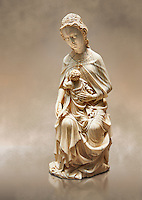 "Medieval Gothic ivory statuette of the Virgin and Child known as ""a La Supplique"" (supplication) made in Paris oat the beginning of the the 15th century.  inv 2745, The Louvre Museum, Paris."