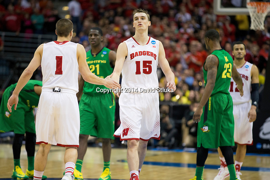Wisconsin Badgers teammates Sam Dekker (15) and Ben Brust (1) celebrate during the third-round game in the NCAA college basketball tournament against the Oregon Ducks Saturday, April 22, 2014 in Milwaukee. The Badgers won 85-77. (Photo by David Stluka)