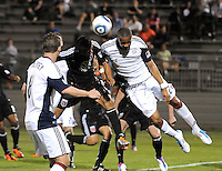 DC United midfielder Andy Najar (14) heads the ball against New England Revolution defender Darrius Barnes (25)  The New England Revolution defeated DC United 3-2 in US Open Cup match , at the Maryland SoccerPlex, Tuesday  April 26, 2011.