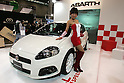 Jan 15, 2010 - Chiba, Japan - Campaign girl of Abarth company stands beside displayed vehicles during the Tokyo Auto Salon 2010 in Chiba, suburb Tokyo, on January 15, 2010. More than 400 companies, associations and groups are displaying more than 600 custom vehicules in the Japan's biggest tuning show which takes place between January 15 and 17. (Photo Laurent Benchana/Nippon News)