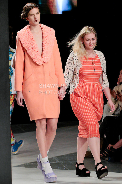 Graduating fashion student Macy Smith, walks runway with model at the close of the 2013 Pratt Institute Fashion Show, on April 25, 2013.