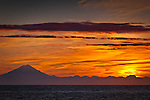 Mt. Redoubt silhouetted at sunset, Southcentral Alaska, Summer.