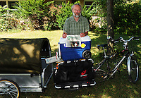 George Zens delivers the Sustainable Times with his customized bicycle that includes a trailer he purchased from Canada, as it was not available in the USA. Zens poses in front of his Middleton, Wisconsin home office on Saturday, August 16, 2008.