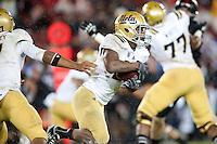 STANFORD, CA-NOVEMBER 30, 2012 - Bruin Jonathan Franklin gains yardage during the PAC-12 Championship at Stanford Stadium.