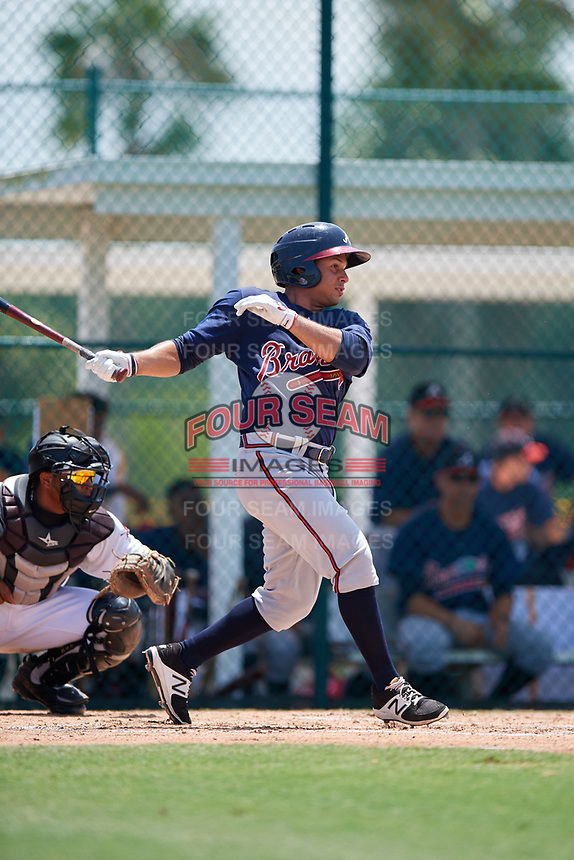GCL Braves center fielder Carlos Baerga (64) follows through on a swing during a game against the GCL Pirates on July 26, 2017 at Pirate City in Bradenton, Florida.  GCL Braves defeated the GCL Pirates 12-5.  (Mike Janes/Four Seam Images)