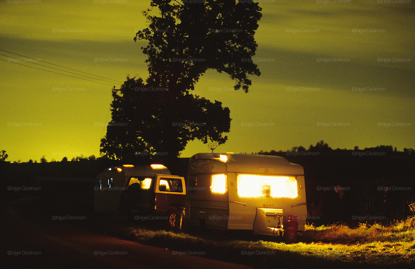 A Romany caravan is parked at the roadside at night. Leicestershire, England