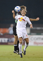 US Open Cup Quarterfinal, Red Bulls' midfielder Chris Henderson (19) heads the ball against DC United defender Ryan Namoff (26). DC United defeated the New York Red Bulls 3-1, Wednesday, August 23, 2006 at RFK Stadium.