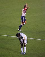 CD Chivas USA forward Laurent Merlin (10)celebrates his goal as LA Galaxy defender Mike Randolph (2) reacts. CD Chivas USA defeated the LA Galaxy in the Super Clasico 3-0 at the Home Depot Center in Carson, CA, Thursday, September 13, 2007.