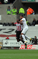 Pictured: Ashley Williams of Swansea (R) battles for a header against Jordan Slew of Sheffield United (L).Saturday 07 May 2011<br /> Re: Swansea City FC v Sheffield United, npower Championship at the Liberty Stadium, Swansea, south Wales.