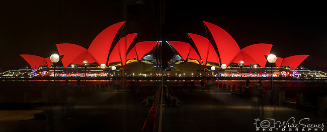 Reflections of the Sydney Opera House bathed in red in Hyatt Hotel window for the 2017 Chinese New Year Celebrations - Year of the Rooster in Sydney, NSW, Australia