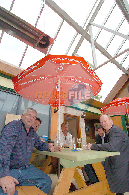 Tony Ward Left owner of Reds bar in Drogheda having a smoke in the bar which now has no roof...Photo Fran Caffrey Newsfile.ie..This Picture has been sent to you by Newsfile Ltd..The Studio,.Millmount Abbey,.Drogheda,.Co. Meath,.Ireland..Tel: +353(0)41-9871240.Fax: +353(0)41-9871260.ISDN: +353(0)41-9871010.www.newsfile.ie..general email: pictures@newsfile.ie