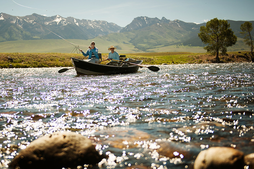 Ann Boyd, of Frederick, Maryland, casts as fishing guide Sean Blaine, of Bozeman, Montana, rows during the salmonfly hatch on the Madison River near McAtee Bridge.