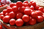 Basket of tomatoes at the Analakely market in Antananarivo in Madagascar