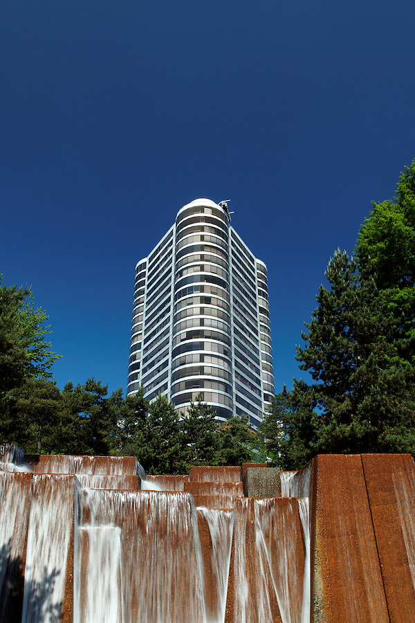The Portland Plaza condominium towers above waterfalls in Keller Fountain Park, downtown Portland, Multnomah County, Oregon, USA