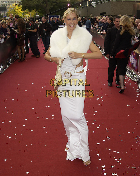 "TANIA BRYER.ITV's ""The Celebrity Awards"".London 26 September 2004.full length, white dress, fur collar, Tanya, buckle.www.capitalpictures.com.sales@capitalpictures.com.©Capital Pictures"
