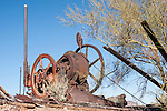 The Vulture Gold Mine, Vulture City, Arizona; a rusty, old motor sits above the entrance to the Mine Shaft of the Vulture Gold Mine