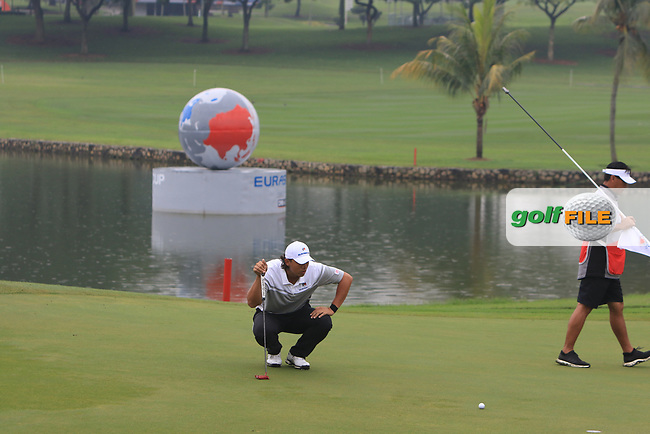 Gavin Green (Asia) on the 3rd green during the Saturday Foursomes of the Eurasia Cup at Glenmarie Golf and Country Club on the 13th January 2018.<br /> Picture:  Thos Caffrey / www.golffile.ie