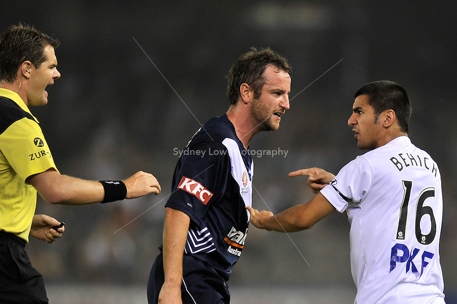 MELBOURNE, AUSTRALIA - JANUARY 22: Grant Brebner of the Victory and Aziz Behich of the Heart exchange words after a tackle in round 24 of the  A-League match between the Melbourne Victory and the Melbourne Heart at Etihad Stadium on January 22, 2011 in Melbourne, Australia. (Photo Sydney Low / AsteriskImages.com)
