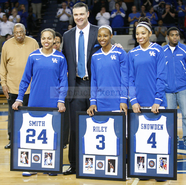 UK Hoops Head Coach Matthew Mitchell stands with the three seniors Amber Smith (L), Crystal Riley (M), and Keyla Snowden (R) during the first half of UK Hoops senior night game vs. South Carolina at Memorial Coliseum in Lexington, Ky., on Thursday, Feb. 23, 2012. Photo by Tessa Lighty | Staff